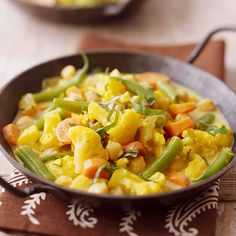 Vegetable-and-Garbanzo Curry  Curry powder, coconut milk, and a sprinkling of fresh basil make this medley of cauliflower, garbanzo beans, green beans, and carrots rich and full-flavored.