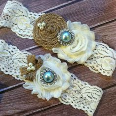 This lovely vintage garter set is shown in aqua with ivory shabby chiffon flowers and ivory pearl rhinestone centers.