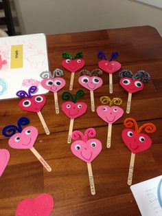 Valentine Lovebugs- construction paper hearts, googly eyes, craft sticks and pipe cleaner.