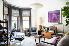 Brooklyn house tour: studio four nyc wallpaper apartment therapy. Round Coffee Table Modern, Coffee Tables, Beige Headboard, Tan Leather Sofas, Brooklyn House, Tiny Living Rooms, Living Spaces, Beige Walls, Room Colors