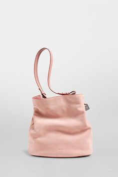 Sophisticated and functional, the Amberline has a unique shape that can be worn open or cinched at the top for a more refined look. Adjustable straps for functionality. Interior pockets keep essentials safe, and metal feet protect the base of the bag.