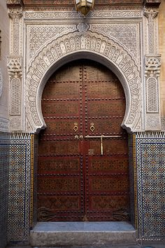 Fez is an ancient capital of the area in Morocco and it definitely shows. The old city is a windy maze that is similar to Jerusalem's old city: covered, sweaty, dark, and full of flavor and activity. These old mosque doors show the intricacy and importance the people place on their religion. Care is taken here even over the homes to clean and beautify these large, wooden ports that house a holier place.