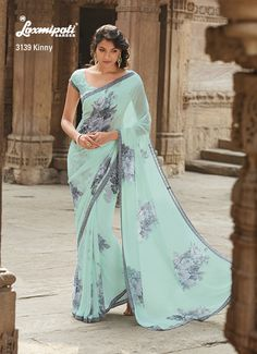 Here is the saree that carries desi elegance at its best! As it features georgette material it is sure to give majestic feel as you drape.