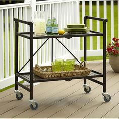 The 15 products you need, from umbrellas to bar carts to fire pits, to make your patio or deck feel like an outdoor oasis.
