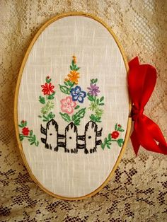 This would be a nice way to salvage the good part of an other wise damaged needlework piece.  vintage embroidery wall hanging