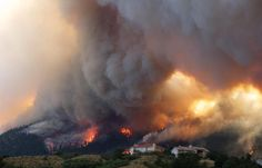 Fire from the Waldo Canyon wildfire burns as it moved into subdivisions and destroyed homes in Colorado Springs, Colorado, on Tuesday, June 26, 2012.  AP Photo/Gaylon Wampler