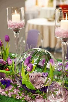 Use a clay saucer painted the colors of the table settings and turn a glass bowl over arranged flowers. Grab a few pieces from your yard and instant arrangement.