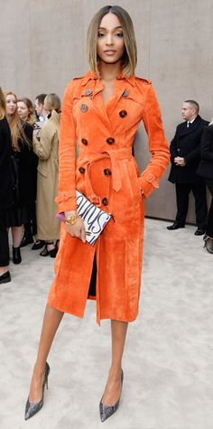 It-Brit model Jourdan Dunn lit up the Burberry Prorsum fall/winter men's fashion show in a cheery orange Burberry Prorsum trench that expertly styled with a charming graphic clutch, gold jewelry, and gray snakeskin pumps.