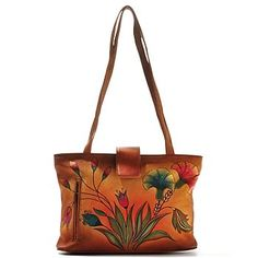 Anuschka Hand-Painted Leather Tote Bag....I have never seen Anuschka bags before tonight. I love the Denim Floral Paisley pattern but it sells out quickly. This is kind of different and the colors are nice..not too flashy or bright