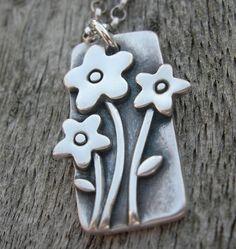 Lovely  fine silver flower pendant.