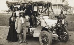 Car decorated with flowers with Benjamin Purnel and his wife Mary Purnell, co-founders of the House of David, standing and Cora Mooney seated in the car at the Israelite House of David, Benton Harbor, Michigan House Of David, Benton Harbor, Vintage Postcards, Antique Cars, Carnival, Park, Michigan, Travelling, Truck