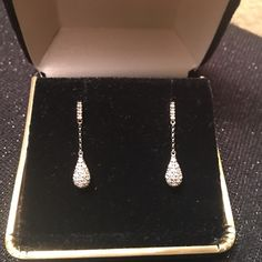 Genuine DIAMOND teardrop earrings  Delicate and sparkling with pave diamonds, these dazzling earrings are classics. Dangling dainty teardrops encrusted in genuine diamonds set in 10k white gold are a timeless addition to your jewelry collection. Screw back fasteners for pierced ears. Chanel Tiffany Gucci Cartier like in style! Pictures of Kate Middleton used for style reference. Not the actual earrings.  Tiffany & Co. Jewelry Earrings