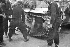 A Tiger 1 getting some road wheels removed for maintenance.
