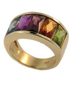 18KT gold. The ring is set with five semi precious rectangular cut gem stones. Blue Topaz, Amethyst, Garnet, Citrine, Peridot.