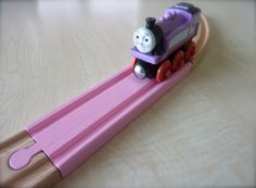 Pastel colored Brio wooden train tracks.  www.facebook.com/woodpeckers.ch #decoartprojects
