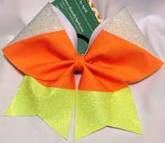 Bows by April - Candy Corn Glitter Cheer Bow, $15.00 (http://www.bowsbyapril.com/candy-corn-glitter-cheer-bow/)