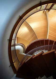 "Chenequa Residence - Wisconsin.  -  This curvaceous Wisconsin home was custom built by architect Robert Harvey Oshatz. The inside features a gorgeous spiraling hem-lock roof that ""sweeps over the entry and lifts the upper floor before disappearing from plain view"". The Chenequa Residence is almost completely constructed from natural materials that Mr Oshatz sourced himself."