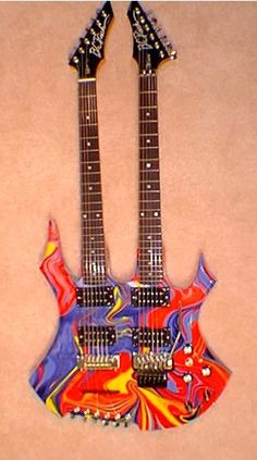 Double neck electric guitar with a crazy design on the body. #electric #guitar #oneofakind