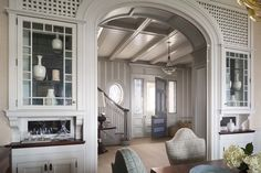 dining room | paneling | arched opening | cased opening | screen | buffet | entry | ceiling | millwork