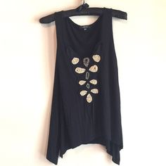 """Soprano beaded asymmetrical tank Soft black tank with a gorgeous beaded bib on front. Beads are tan, grey and blue. Looks so cute with shorts and sandals! One missing bead, I think, it's hard to be sure. One pin-sized hole near the asymmetrical hem. Measures 14"""" across at bust, 24"""" and 26"""" long. Bundle for discount! Soprano Tops Tank Tops"""