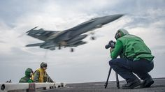 PACIFIC OCEAN (May 23, 2017) Mass Communication Specialist 2nd Class Sean Castellano, from Colorado Springs, Colo.,  records video footage on the flight deck of the Nimitz-class aircraft carrier USS Carl Vinson (CVN 70) in the western Pacific region. The U.S. Navy has patrolled the Indo-Asia-Pacific routinely for more than 70 years promoting regional peace and security. (U.S. Navy photo by Mass Communication Specialist 2nd Class Rebecca Sunderland/Released)