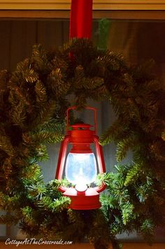 The battery operated red lanterns really light up our cottage for the holidays! So easy to add to a plain wreath, too!