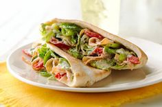 Caesar pockets : romaine lettuce 6 oz. OSCAR MAYER Deli Fresh Smoked Turkey Breast, cut into strips 1/4 cup drained roasted red pepper strips 3 Tbsp. KRAFT Grated Parmesan Cheese 1/4 cup KRAFT Classic Caesar Dressing 4 pita breads, warmed, cut in half