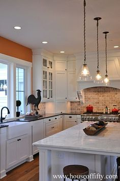 Isabella & Max Rooms: Street of Dreams Portland Style - House 5   Kitchens    Bricks, Cabinets and White Cabinets
