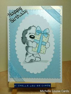 Cute fluffy dog with present stamp birthday card