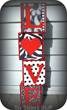 You can find out how to make these Love Blocks by going to sixsistersstuff.com