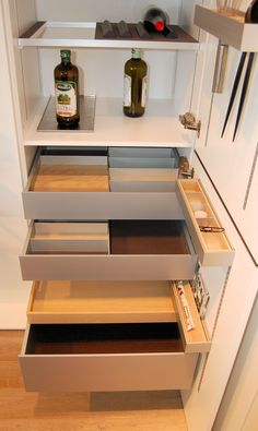 SieMatic aluminum internal drawer options. Split shelf option with metal tray and wine storage options.
