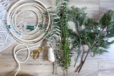 Homemade wreaths in the family room Christmas Holidays, Christmas Wreaths, Christmas Decorations, Jones Design Company, Behind Couch, Farmhouse Christmas Ornaments, Homemade Wreaths, Minimalist Christmas, Diy Wreath