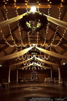 Winter wedding at Lains Barn, with our huge fairy light canopy
