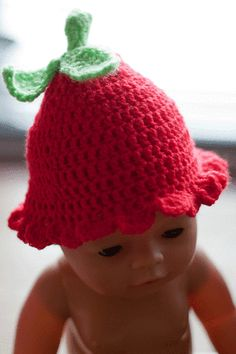 I like the strawberry hat- not the creepy baby doll!