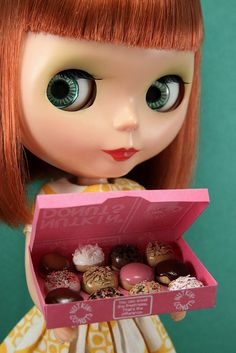 Is it a baker's dozen? No matter, she's adorable with her pink box of donuts. Makes me hungry looking at that box!
