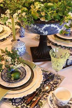 bowl on wooden pedestal - gorgeous tablescape blue and white inspired place settings