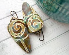 Fancy Fronds  These lightweight polymer clay earrings have a tropical frond swirl design in gold, brown and turquoise. This design will never be exactly duplicated! The long, thin tiles have been sealed and buffed to a soft shine. Brown textured back is stamped with my signature WO. Hypoallergenic ear wires.  I take great care in creating my pieces. They are painstakingly crafted to the best of my ability. I love what I do and hope this shows in my work. Tile: 3/8 x 1-1/2 x 1&#...