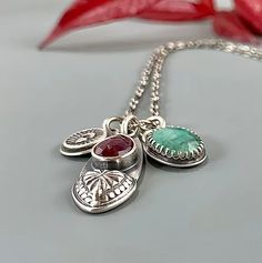 Ruby and Emerald 'Two Hearts' Charm necklace   Shalondesigns Two Hearts, Emerald, Handmade Jewelry, Charmed, Bracelets, Handmade Jewellery, Jewellery Making, Emeralds, Diy Jewelry