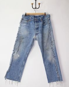 Made in Malibu from  vintage Levi's 501. Unseamed, cut, and sewn back  together with love and care. Some of my holes are repaired with carefully  selected fabrics. I am one of a kind, just like you :)  You can adjust my hem to any length, just cut the way you like and machine  wash / tumble dry