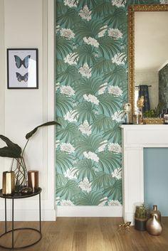 Pourquoi ne pas mettre une tapisserie dans l'enclavure du mur du salon.