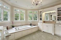 tub surround at level of vanity countertop; side of tub paneling = vanity door profile.