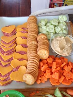 Valentines snacks--heart-shaped cheese slices served with crackers.