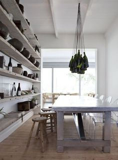 """the 2"""" built in floating shelves appear to be knotty pine, unfinished - something to consider vs. white.  like the rustic wood stools w. contemporary chairs (no ghost chair please).  sean could probably make the pendant for us, funny"""