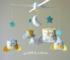Baby Mobile - Yellow and Gray Mobile - Owl Baby Mobile - Mobile Owls - Nursery Mobile - Neutral Mobile - You can pick your colors :). $95.00, via Etsy.