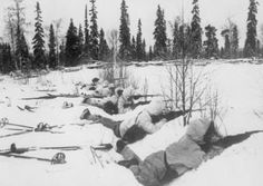 Blood in the Snow: The Winter War: A Finnish ski patrol, lying in the snow on the outskirts of a wood in Northern Finland, on the alert for Russian troops, 12 January 1940.