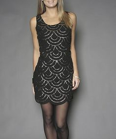 Web pattern sequin dress 50$ suzy shier