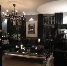 All black furniture in dark living room