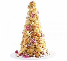 "The ""Croquembouche"" is a traditional French wedding cake. Cream puffs, stacked- adorned with spun sugar and flowers. Monterre's Pastry chef does this!"