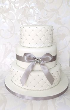 wedding cakes to the moon and back | White Quilted Wedding Cake, with Diamantes, Brooch and Bow, with duo ...