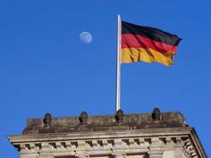 German flag being flown over Berlin